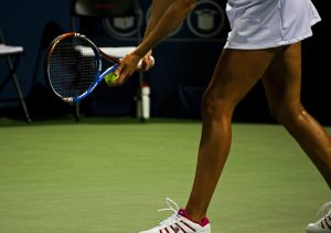 womans tennis player ready to serve